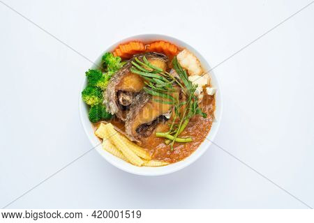 Fried Snakehead Fish In Sour Soup Made Of Tamarind Paste With Vegetable Omelet - Asian Food Style Or