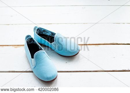 Summer Moccasins On White Wooden Background. Trendy , Fashionable Cotton Shoes.pair Of Blue Trendy L