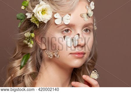 Portrait Of Sweet Perfect Young Woman With Healthy Blonde Curly Hair, White Spring Flowers And  Butt