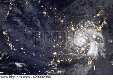 Huge Hurricane Over America, Night Photography. Lights Of Night Cities And The Eyes Of The Hurricane