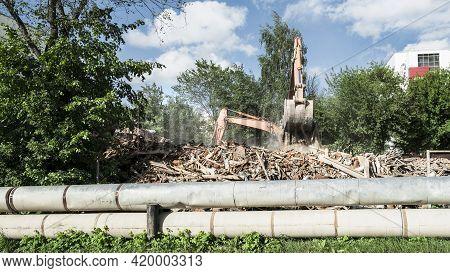 Excavators Demolish The Building. Dismantling Of Construction
