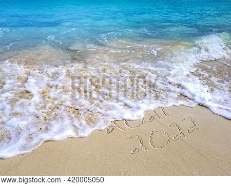 New Year 2022 Text With Turquoise Ocean Water And Beach Sand