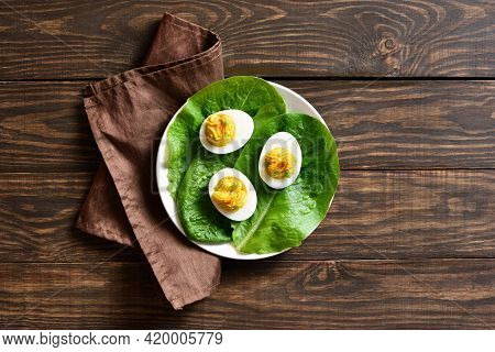 Deviled Eggs With Paprika, Mustard And Mayonnaise On Plate Over Wooden Background With Free Text Spa