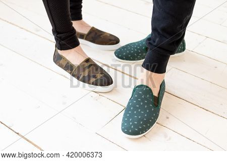 Summer Moccasins On Couple. Trendy , Fashionable Womens And Mens Cotton Shoes.pair Of Trendy Female