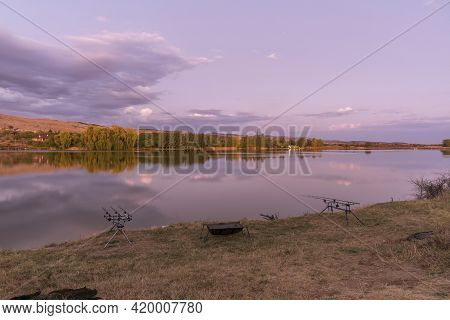Fishing Adventures, Carp Fishing. Angler, At Sunset, Is Fishing With Carp Fishing Technique. Camping