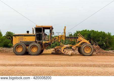 Grader Road Construction Grader Industrial Machine On Construction Of New Roads. The Blade Of A Moto