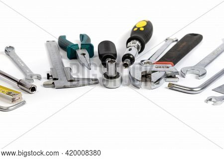 Tools For Construction And Household Repairs On A White Background.