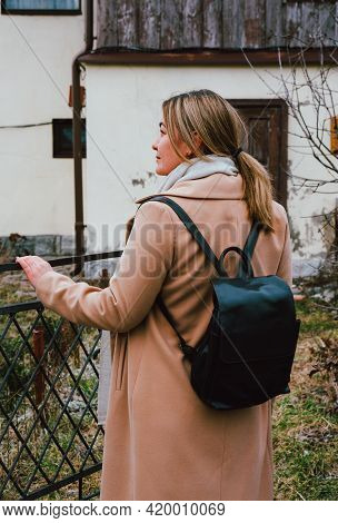 Portrait Of A Beautiful Caucasian Woman In The Park, Beige Cashmere Coat, Black Leather Backpack, Ca
