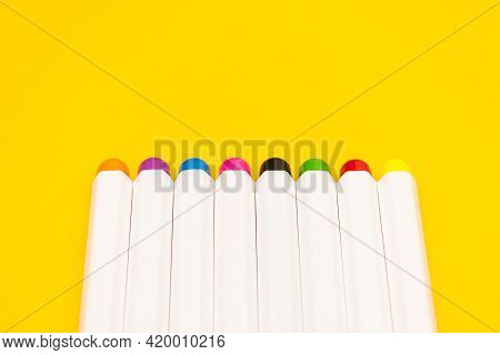 Set Of Felt Pens Isolated On A Yellow Background In Row