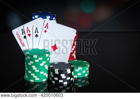 Poker Cards With Five Of A Kind Combination. Close-up Of Playing Cards And Chips In Poker Club. Free