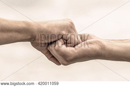 Two Hands, Helping Arm Of A Friend, Teamwork. Helping Hand Outstretched. Friendly Handshake, Friends