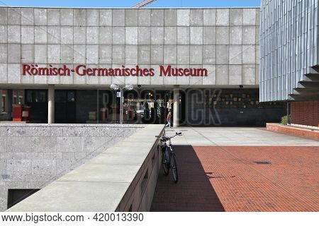 Cologne, Germany - September 22, 2020: People Walk By Romisch-germanisches Museum In Cologne City, G