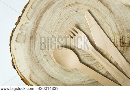 Disposable Bamboo Cutlery: Spoon, Fork, Knife On Wooden Plank. Disposable Recyclable Tableware.