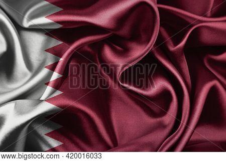 Closeup of silky Qatar flag