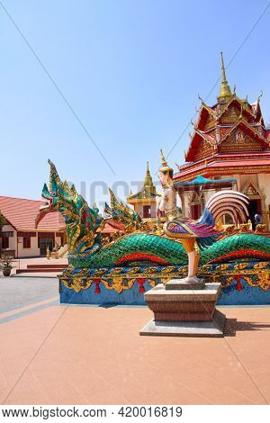 Statues of kinnaris and snakes-nagas near to Pavilion in Pulau Tikus, thai Buddhist temple (Wat Chayamangkalaram), famous tourist attraction in Georgetown, Penang island, Malaysia