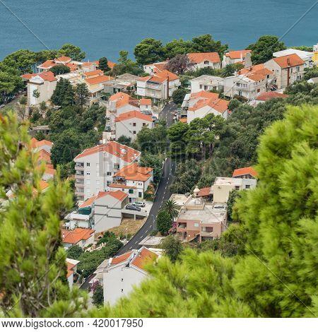 Top view at the coast road along residential buildings in Croatia. Beautiful Adriatic sea coast landscape