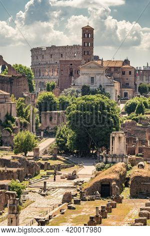 Cityscape with landmarks of ancient Rome. Colosseum and Roman Forum. Famous tourist destinations in Italy.