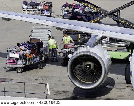 Antalya, Turkey - May 22, 2018. Technical Staff Loads Tourists  Luggage On Board Of Passenger Plane