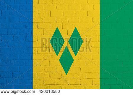 Flag Of Saint Vincent And The Grenadines. Brick Wall Texture Of The Flag Of Saint Vincent And The Gr