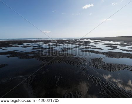 Low Tide Water Pond Lake Structures Pattern Landscape On Black Sand Beach Whatipu West Auckland Wait