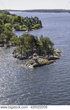 Small Red And White Lighthouse On Island Near Stockholm, Capital Of Sweden. Overhead View Of Buildin