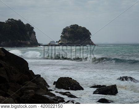 Pacific Ocean Sea Coast Shore Rock Formations At Whiritoa Sand Beach In Hauraki Coromandel Peninsula