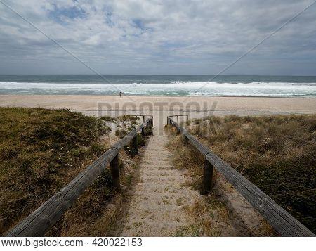 Wooden Stairs Leading To Pacific Ocean White Sand Beach Whiritoa In Hauraki Coromandel Peninsula Wai
