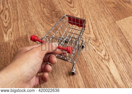 Small Decorative Cart On A Wooden Background Close Up