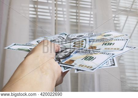 Stack Of Dollars In Hand In Hand Close Up