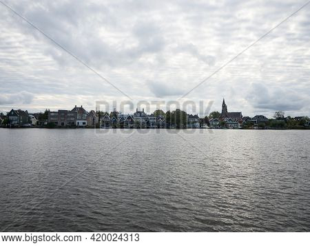 Landscape Panorama Of Typical Traditional Wooden Farm House Building At Zaan River Canal In Zaanse S