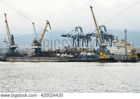 Loading And Unloading Operations In The Water Area Of The Sea Cargo Port In Bad Weather. Copy Space.