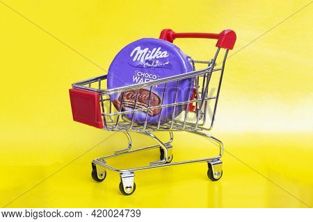 Belarus, Novopolotsk - 09 May, 2021: Round Waffle Milka In Shopping Cart On Yellow Background