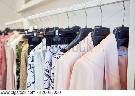 Close-up Of A Hanger With Colorful Clothes. Lots Of Fashionable Stylish Clothes.