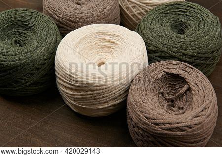 Cotton Threads, Weaving, Multicolored Bobbins Of Thread For Macrame, Hobby On A Dark Wooden Backgrou