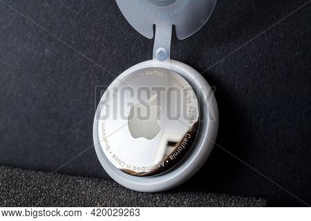 Paris, France - May 2, 2021: Hero Object Shot Of New Airtag With Mirrror Back Engravings Ultra Wideb