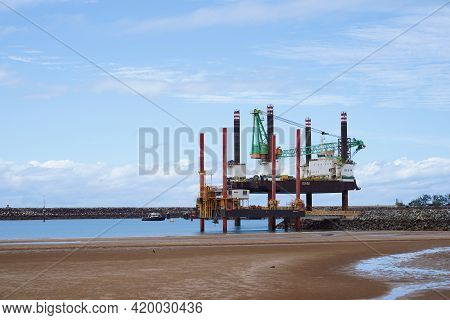 Mackay, Queensland, Australia - May 2021: Two Pile Driving Platforms On The Beach At Hay Point