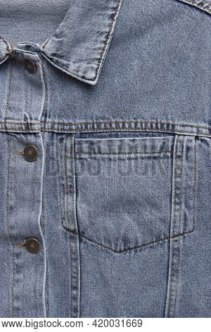 Close Up Of The Front Of A Denim Jacket. Close-up Denim Jacket Pocket. Denim Jacket Background. Blue