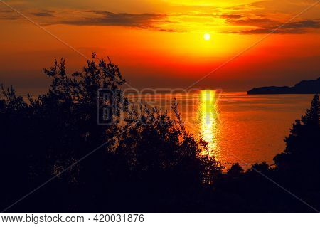 Awesome Sunset Over The Adriatic Sea . Sundown Reflection In The Sea Water . Beautiful Tropical Twil