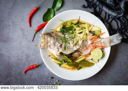 Steamed Grouper Fish With Soy Sauce Chinese Food Style, Steamed Fish On White Plate With Ginger Chil