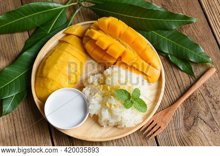 Ripe Mango Rice Cooked With Coconut Milk, Asian Thai Dessert Tropical Sweet Mango Peel And Sliced On