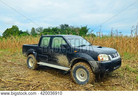 Keningau,sabah-feb 13,2014:4wd Truck Nissan Frontier 2004 Model Types Crew Cabin In The Forest Near
