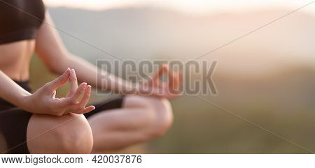 Close Up With Selective Focus Of Hands Woman Sitting In Yoga Lotus Pose Outdoor At Sunrise, Meditati