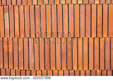 Brick Wall With Red Brick, Orange Brick Vintage Background. Concrete Texture With Vignette. New Colo