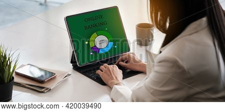 Business Woman Using Digital Tablet And Using Bank Savings Account Application, Account Or Saving Mo