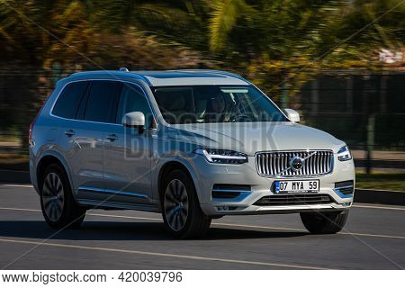Alanya, Turkey - April 18 2021:  White Volvo Xc90 Is Driving Fast On The Street On A Warm Summer Day