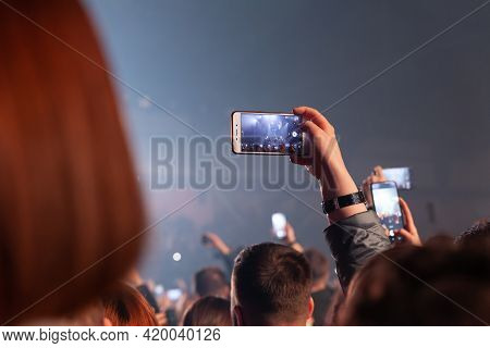 Russia Kemerovo 2021-04-18 People Crowd On Night Party Concert Making Photo And Video On Smartphone