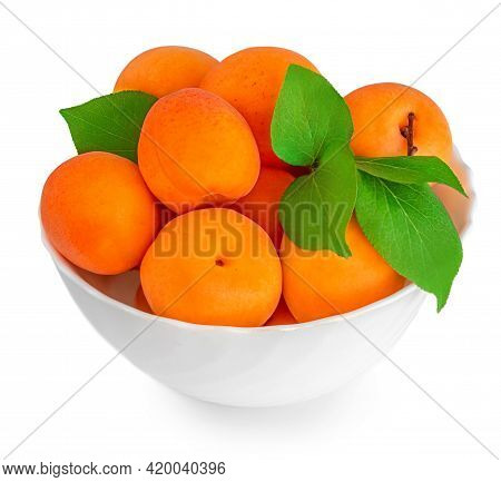 Isolated Apricots In A Bowl. Fresh Apricot  Fruits With Green Leaves Isolated On White Background