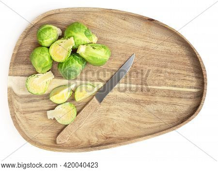 Brussel Sprouts On A Cutting Board With A Knife  Isolated On White Background.  Brussels Sprouts,  T