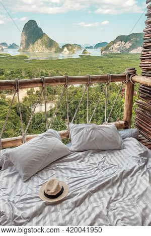 Hat Against Phang Nga Bay Background, Tourists Relaxing In Tropical Resort At Samet Nang She, Near P