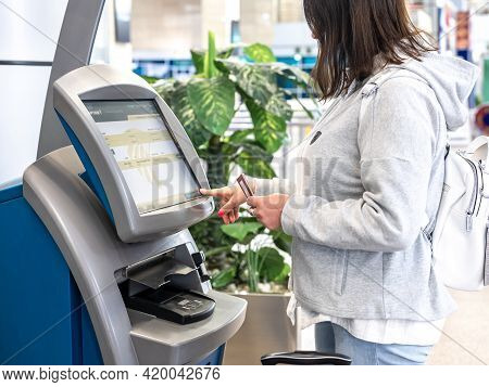 Cairo, Egypt - May 06, 2021: Egyptair Airline Counter For Self-check-in At Cairo Airport. Woman Usin